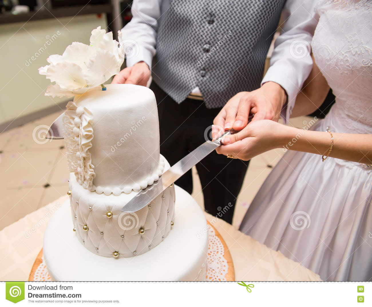 Groom Holds Bride Hand To Cut A Cake Stock Image - Image ...