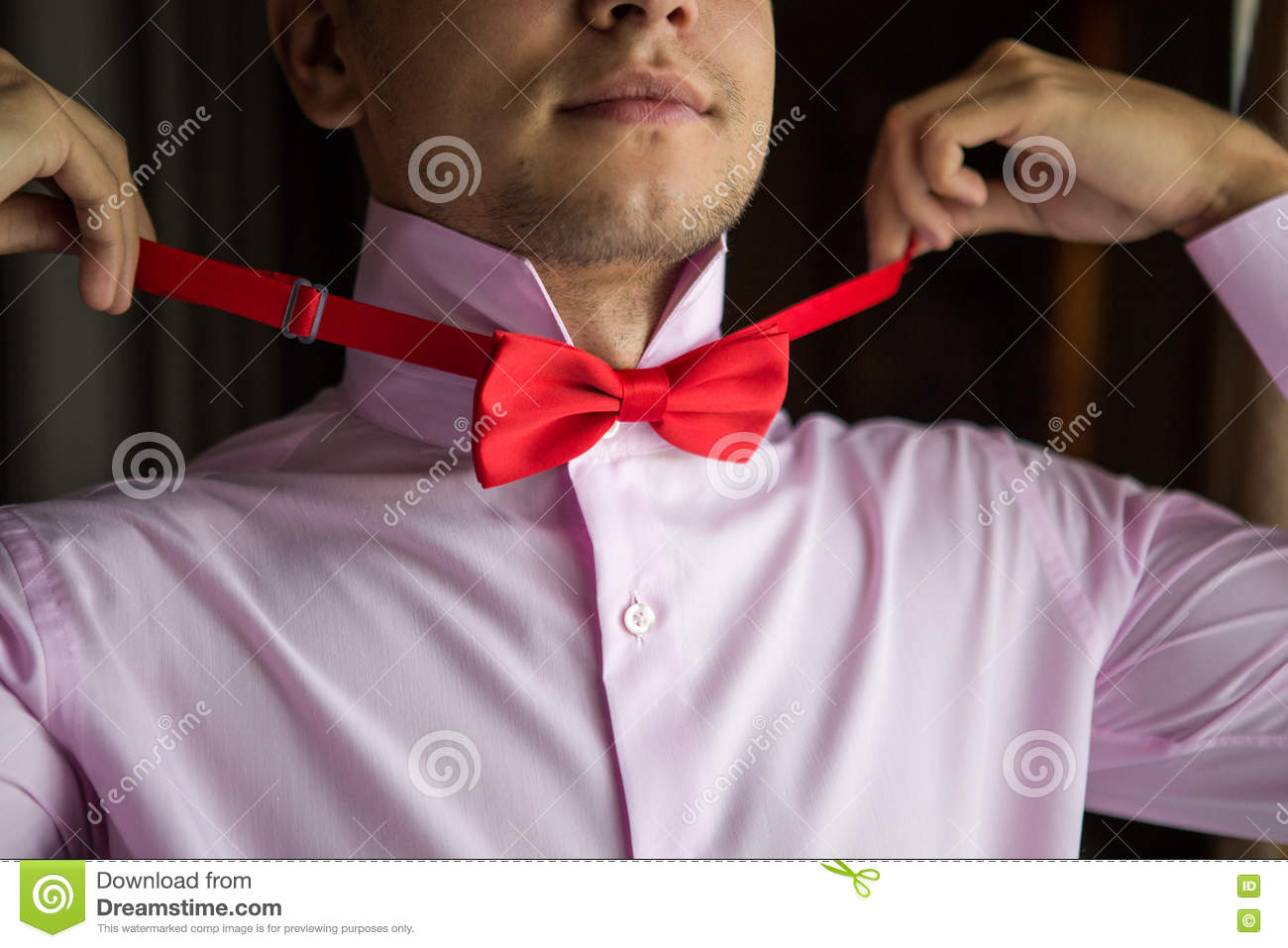 Groom In A Pink Shirt On The Morning Of The Wedding Day. Stock Image ...