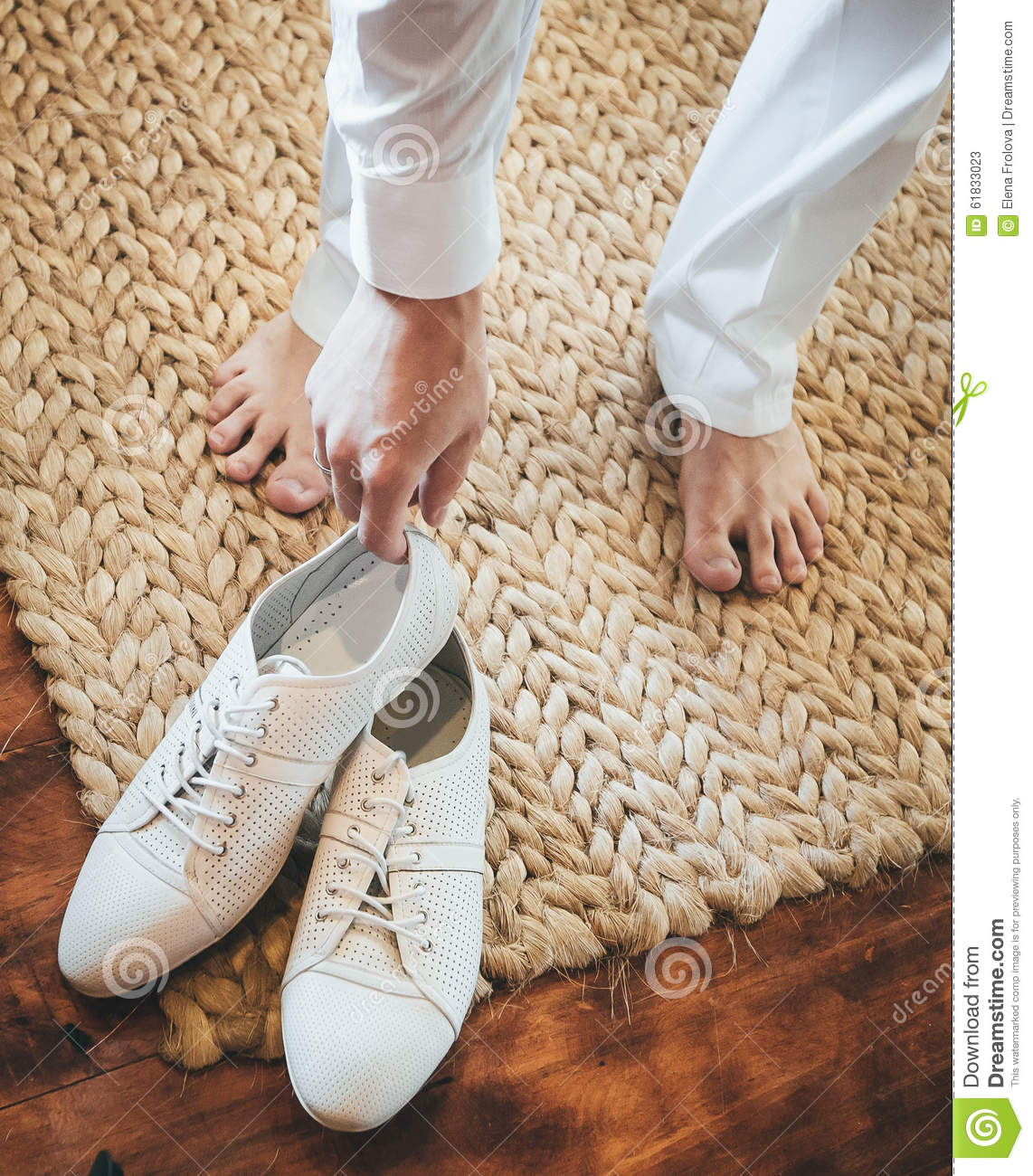 Groom Putting On White Shoes For The Beach Wedding On A Tropical