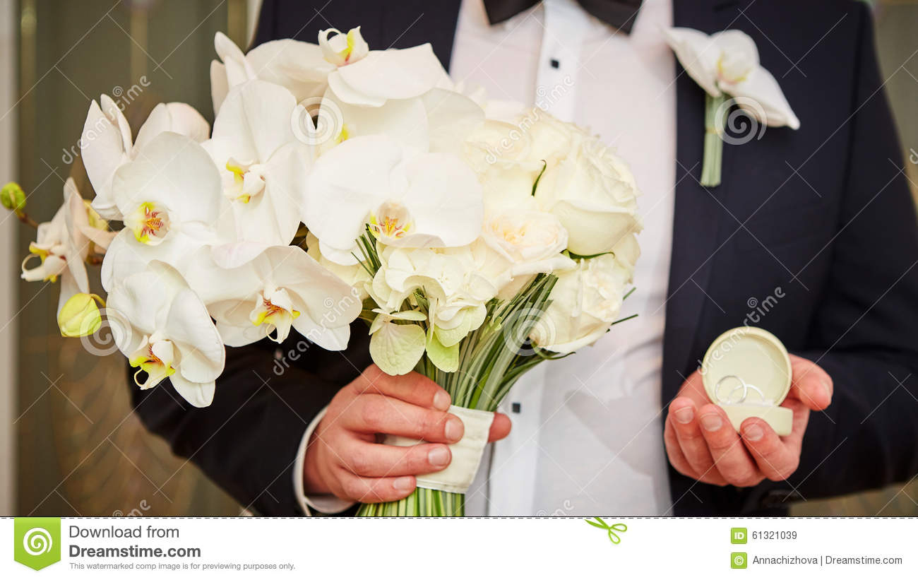 Groom with rings and bouquet