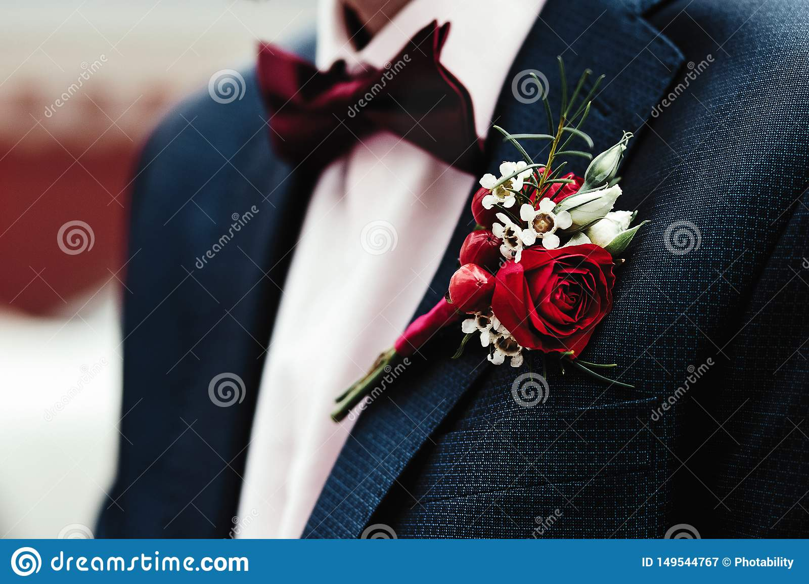 Groom`s boutonniere on the jacket