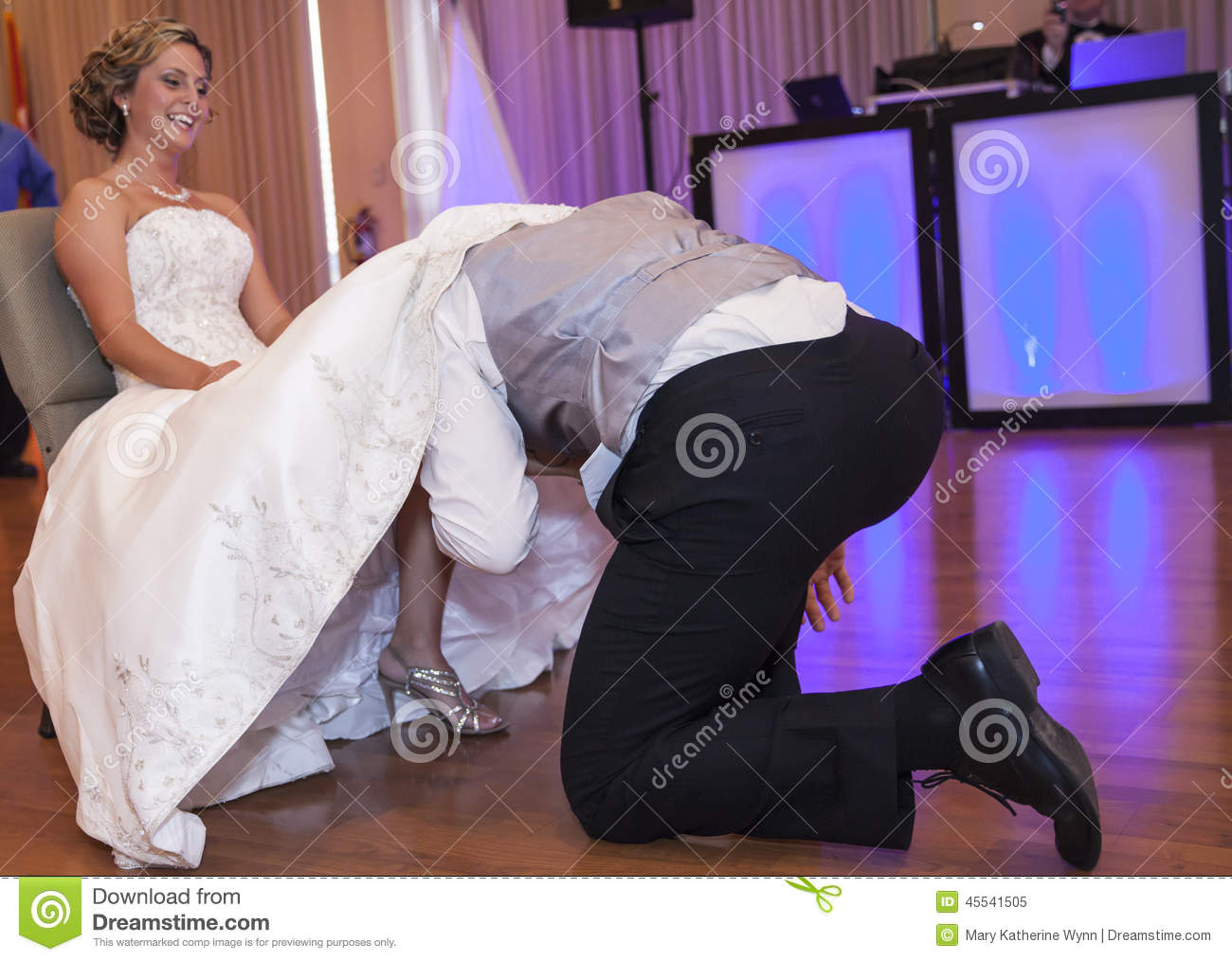 Groom taking off garter stock photo image 45541505 for Garter under wedding dress