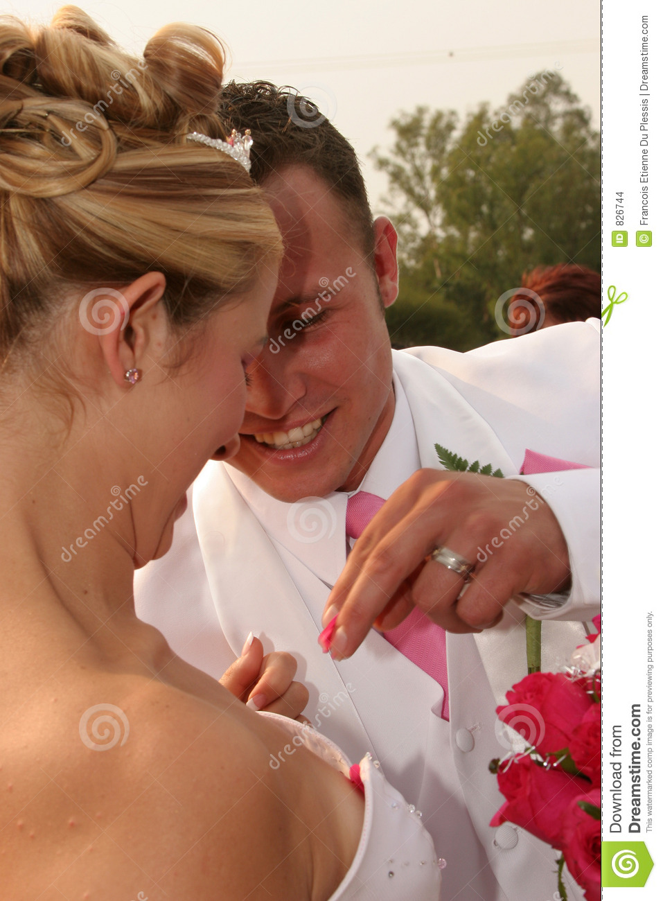 Groom taking out some roses