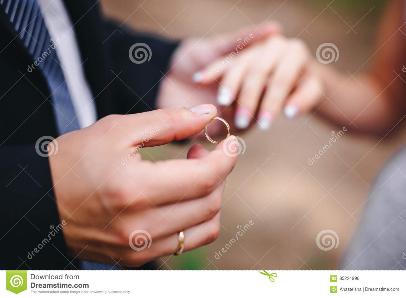 Groom wears the ring bride stock photo. Image of bride - 85224996