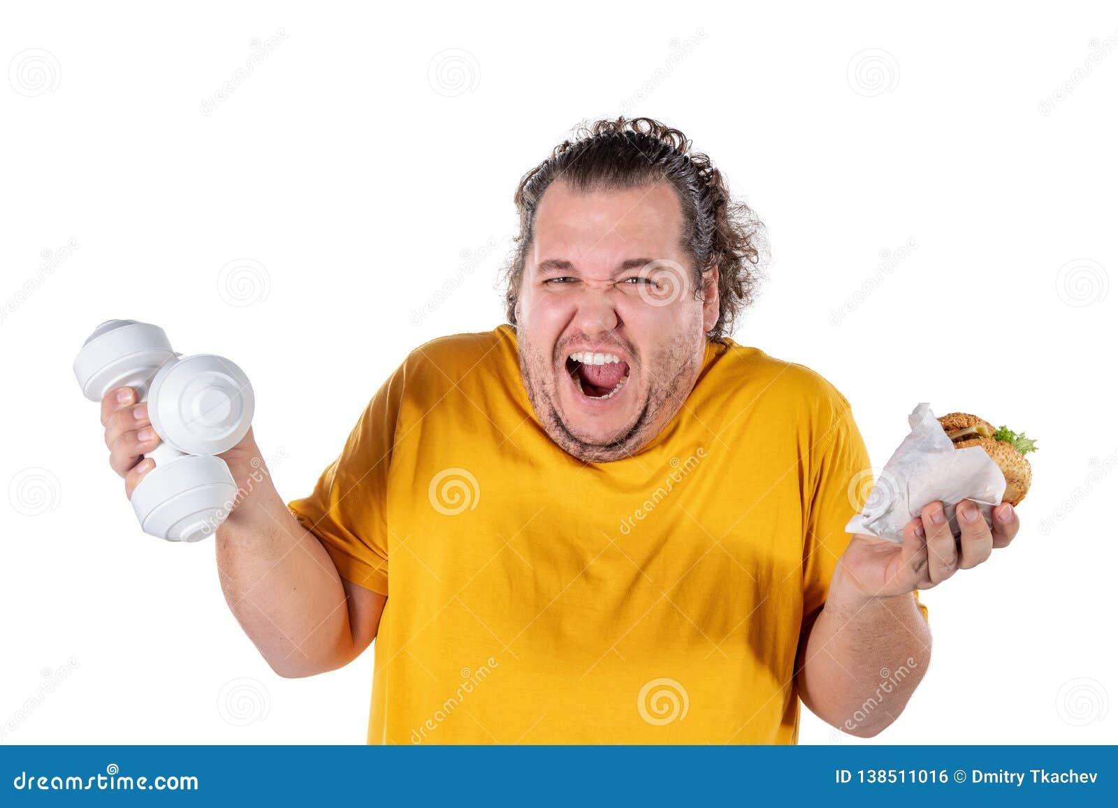 Grosse nourriture malsaine mangeuse d hommes drôle et essai de prendre l exercice d isolement sur le fond blanc