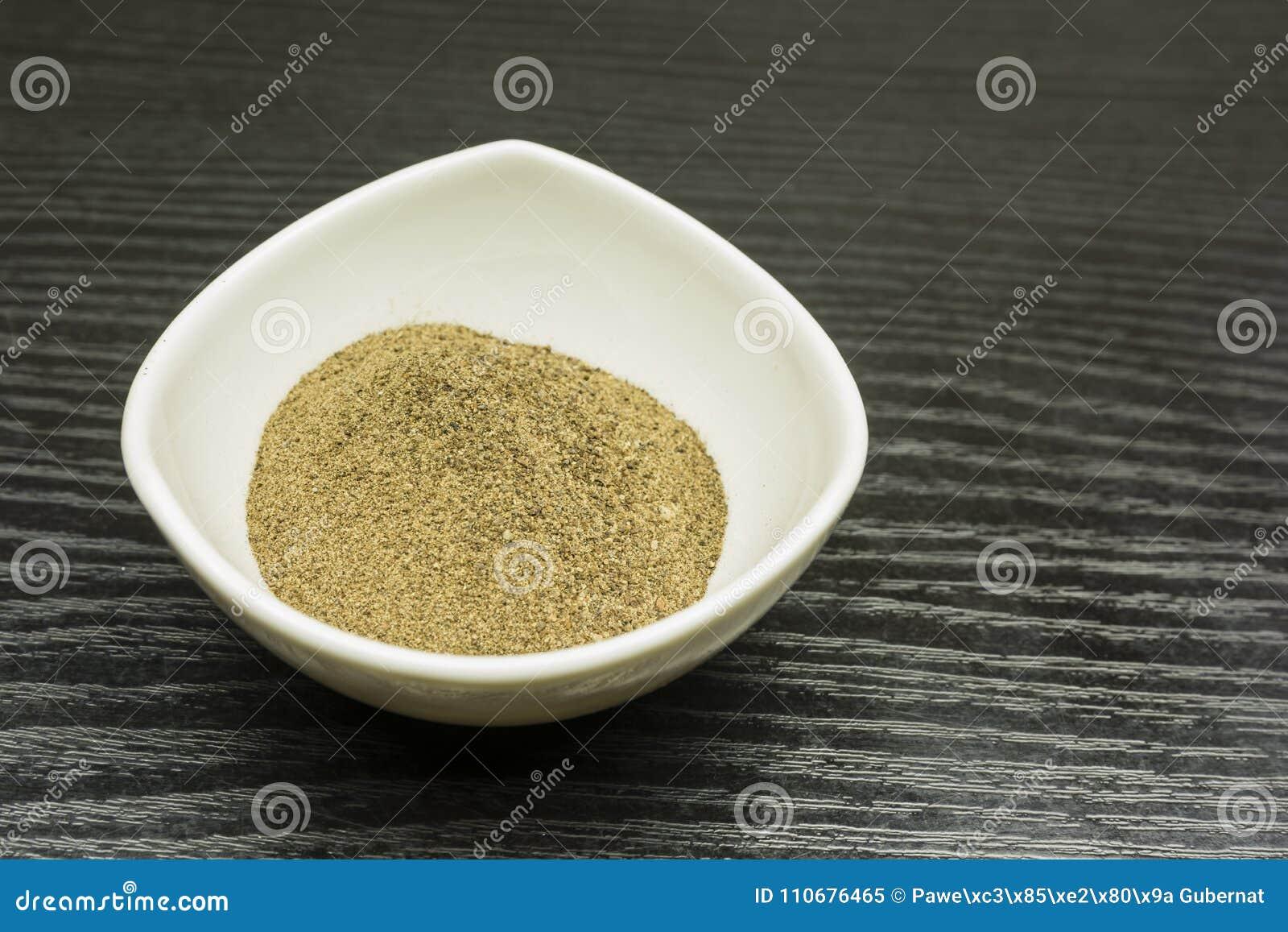 Ground black pepper in a bowl.