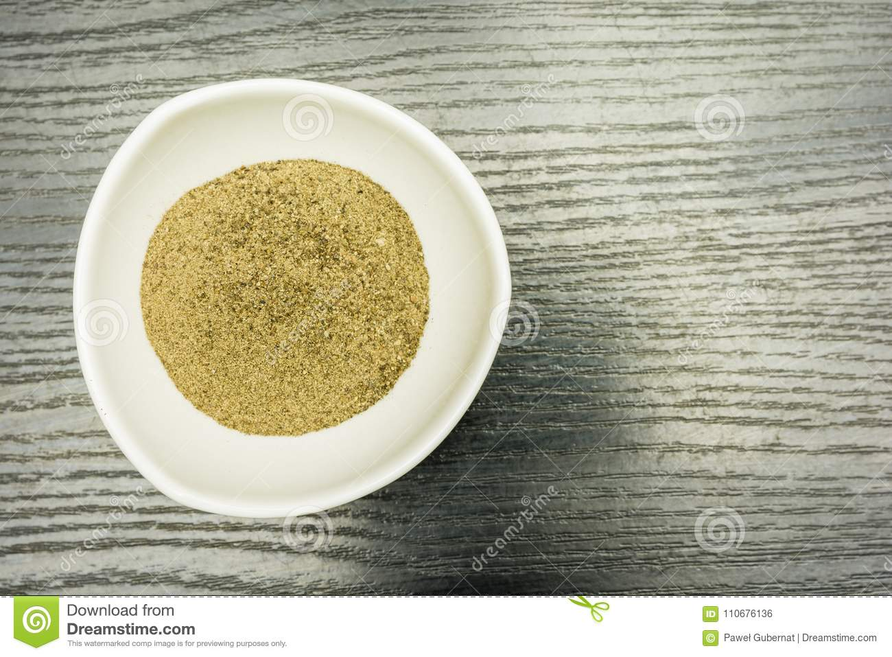 Ground black pepper in a bowl. View from above.