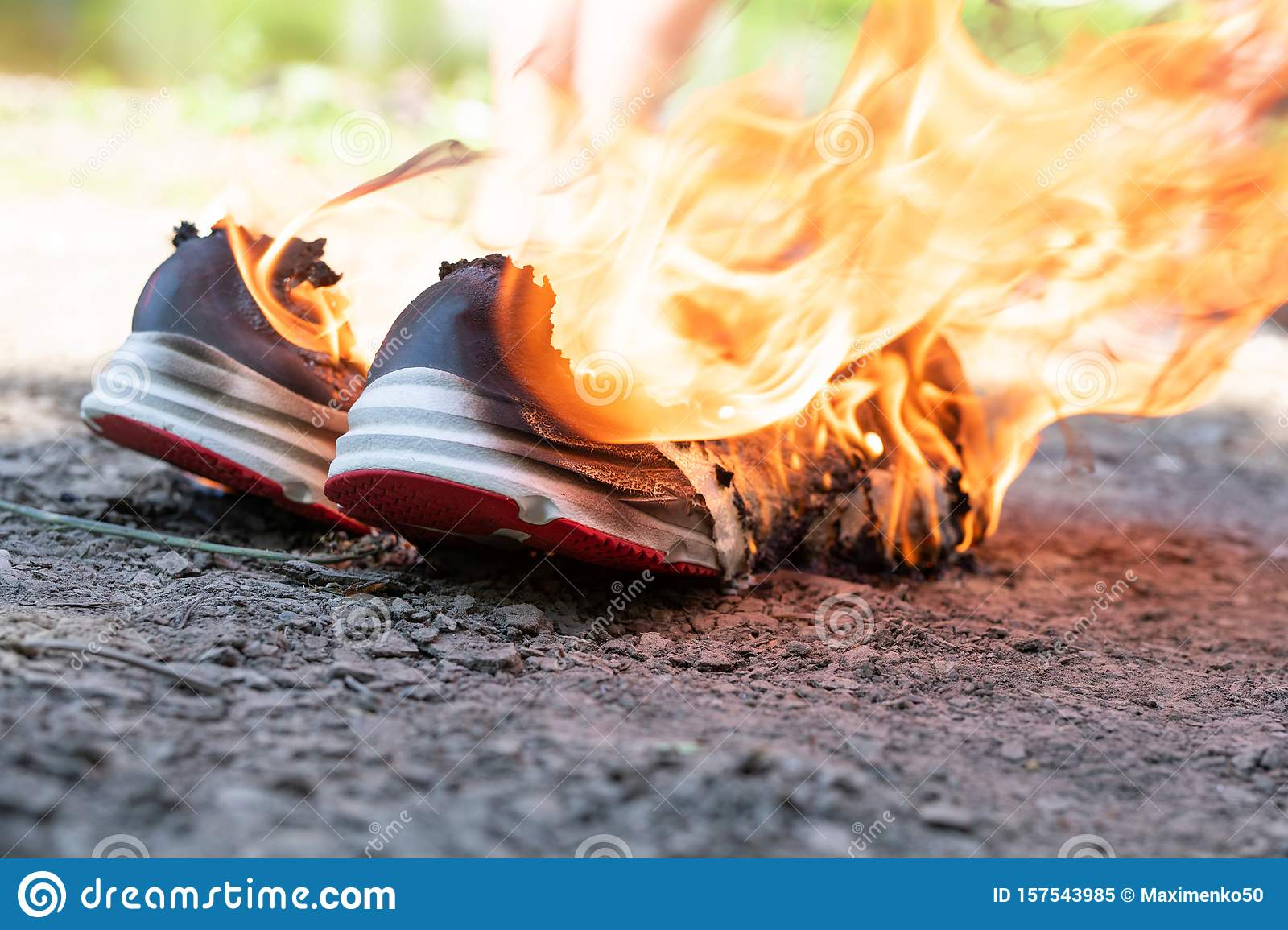 Burning Sneakers, Sports Shoes On Fire