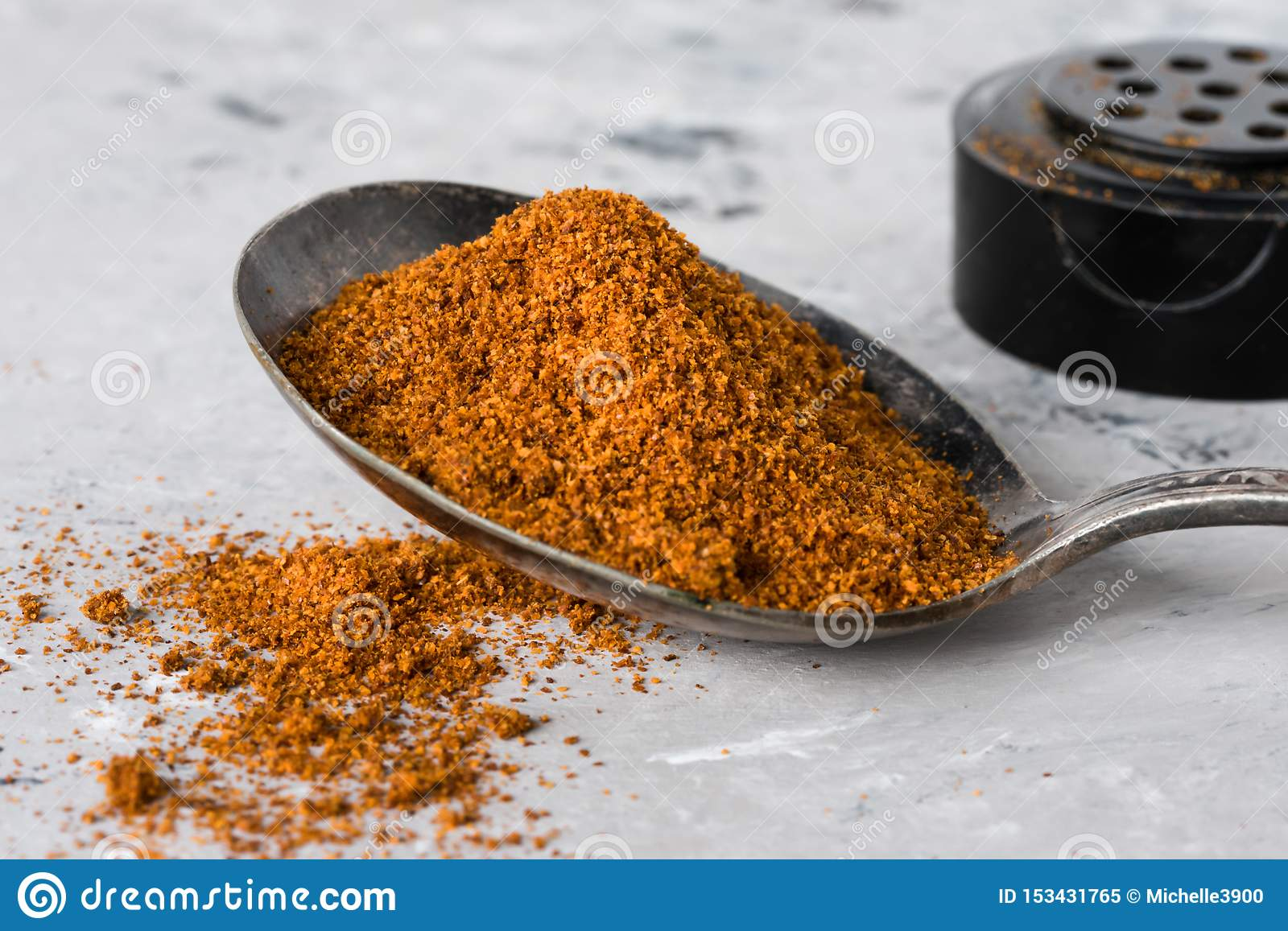 Ground Cayenne Pepper Spilled from a Vintage Spoon