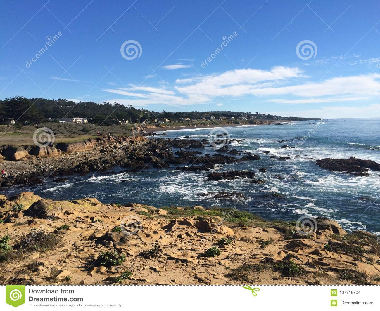 Cambria overview of rocky shoreline against the tide