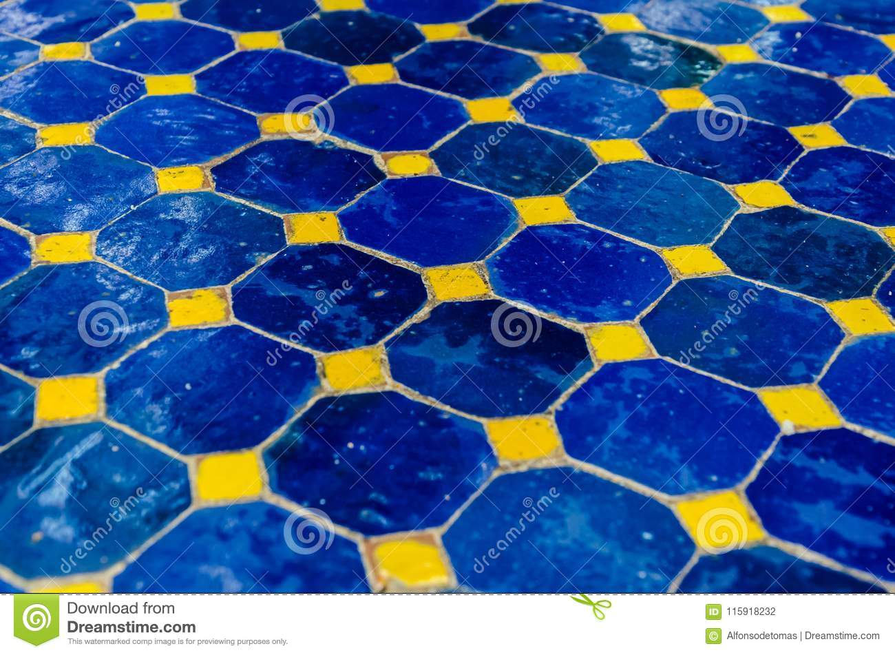 Ground Made With Ceramic Tiles In Blue And Yellow Stock Photo