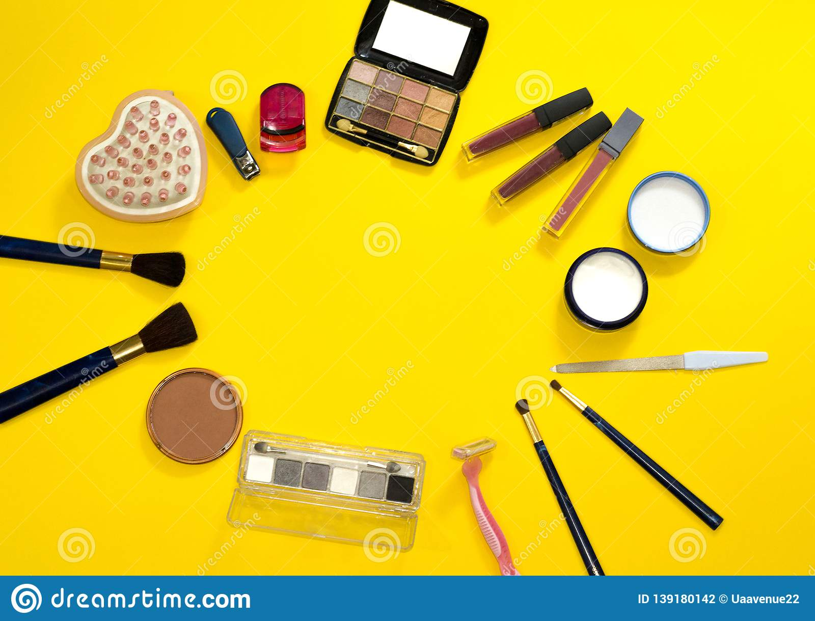 Group of accessories for makeup, hygiene and body care on yellow background. Woman& x27;s workplace with copy space. Salon spa
