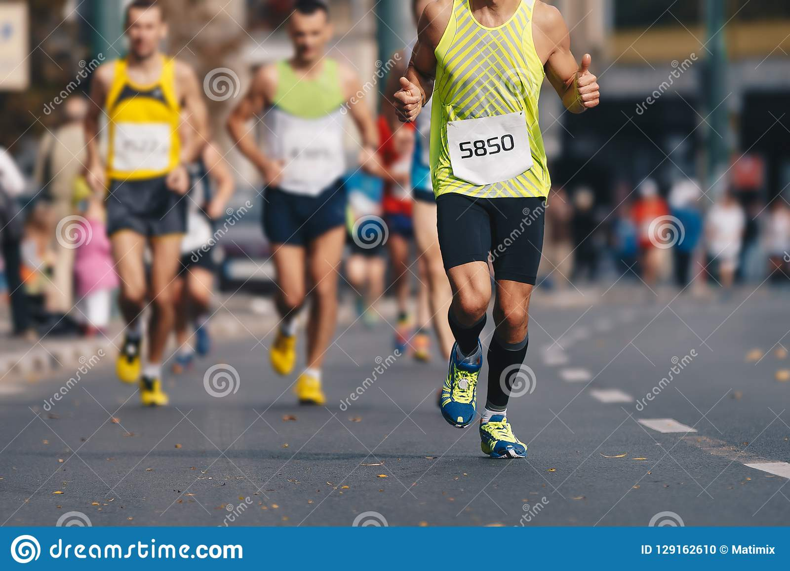 Autumn fall urban marathon run. Group of active people running marathon race in the city downtown
