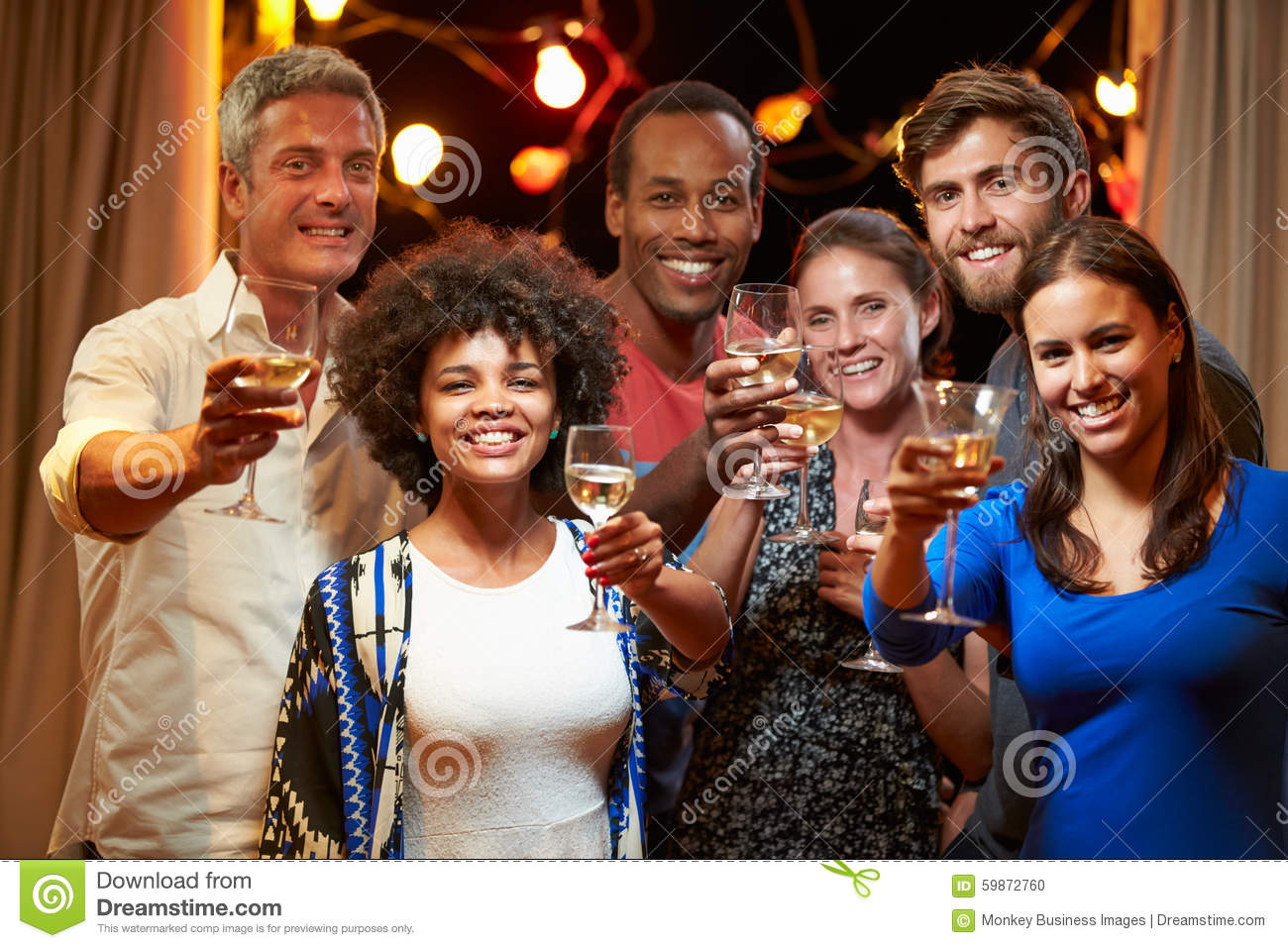 Group of adult friends at party making a toast