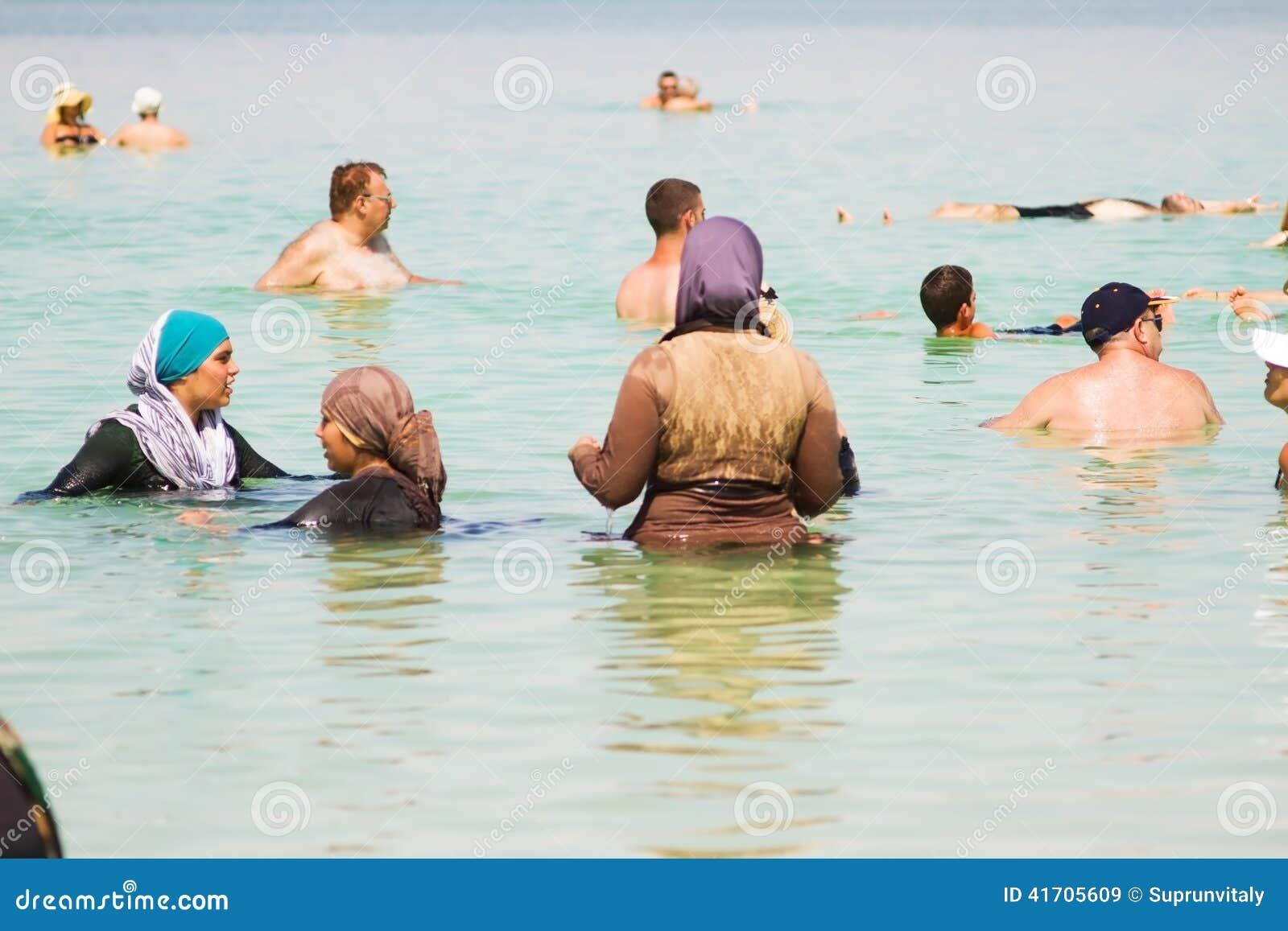 Group of arab women on the beach .