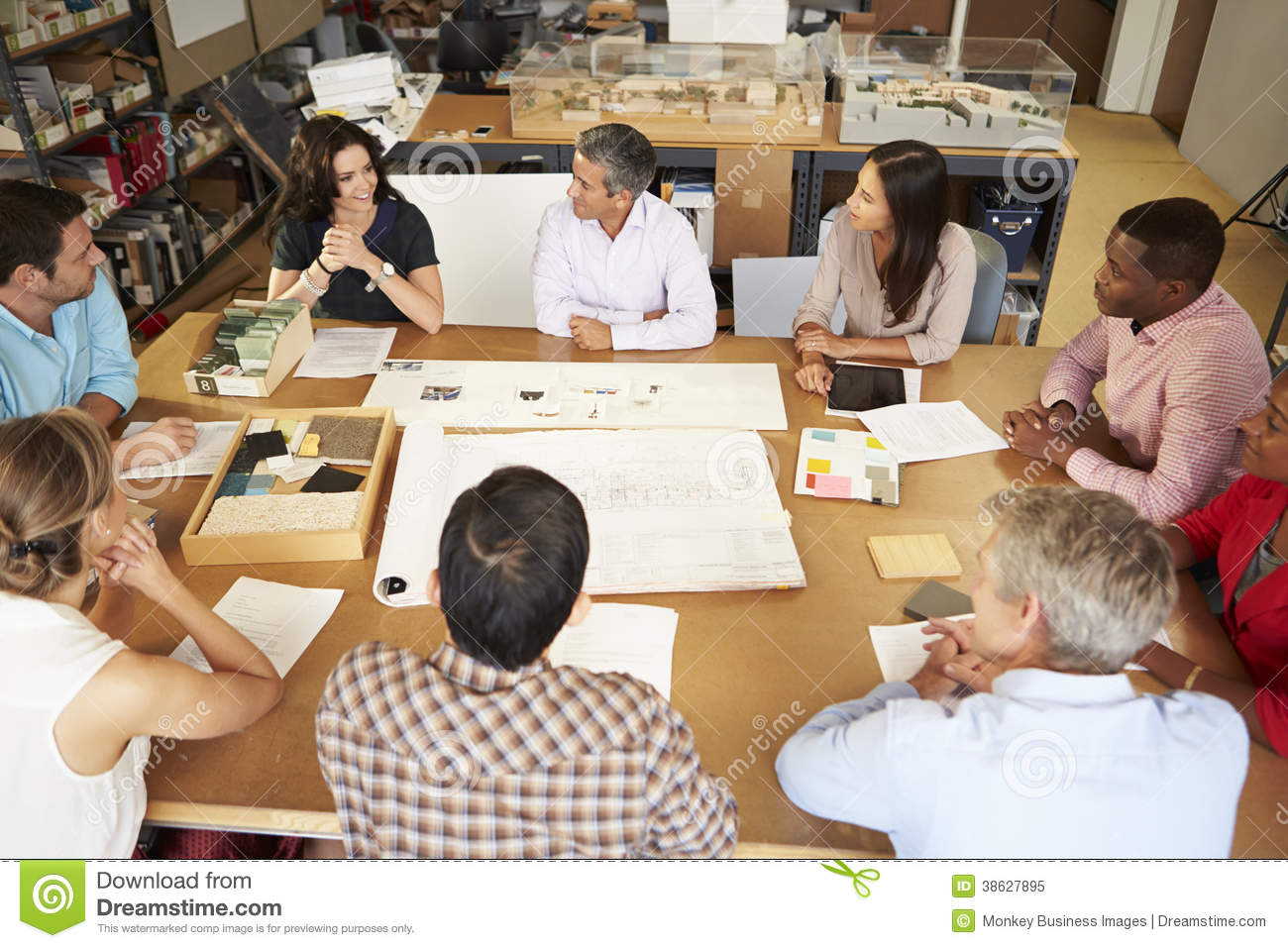 Surprising Group Of Architects Sitting Around Table Having Meeting Beutiful Home Inspiration Ommitmahrainfo