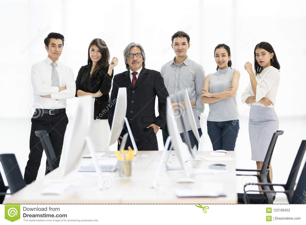 Group of 6 Asaina business people standing together in modern of