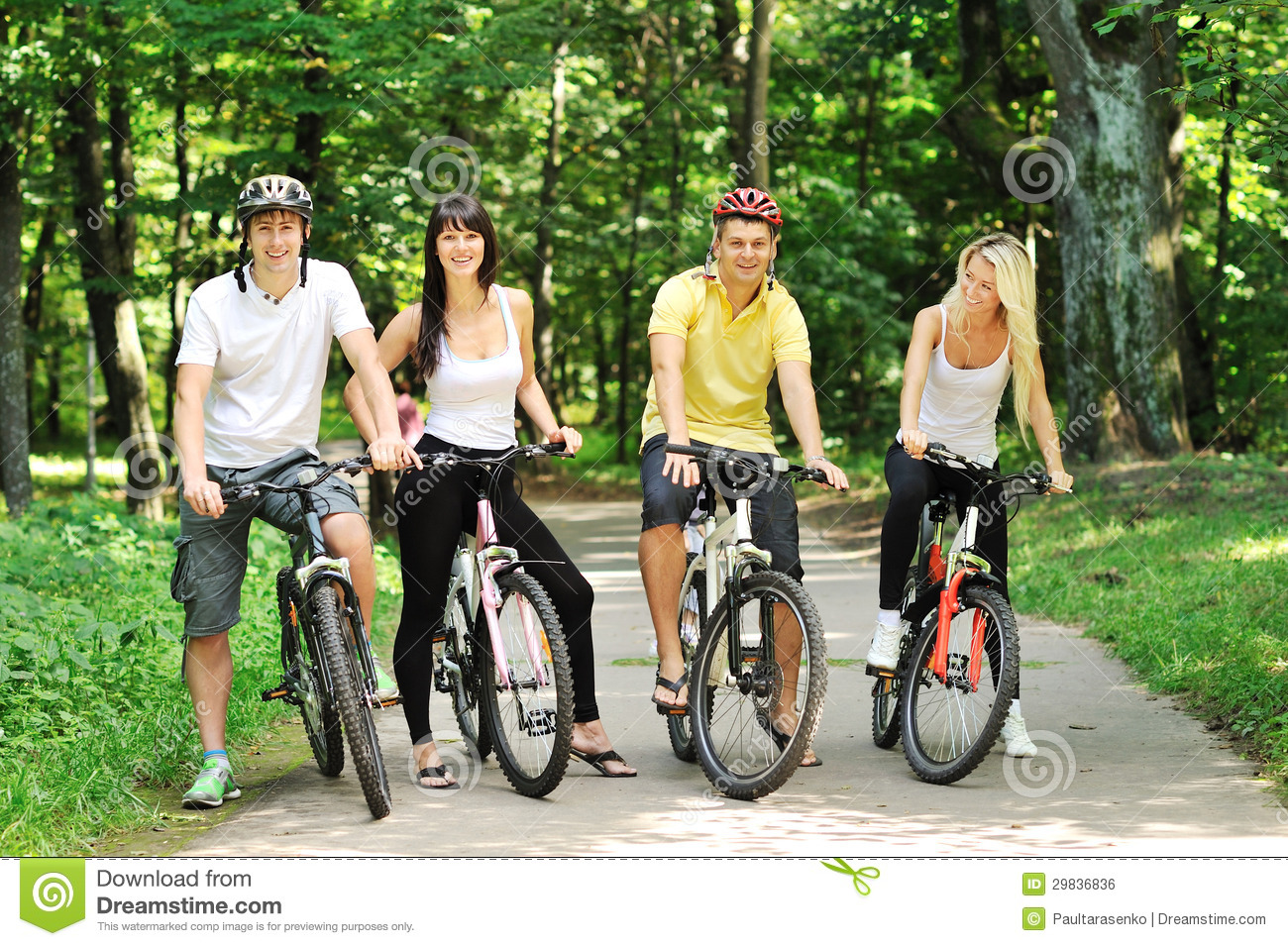 Group Of Attractive Happy People On Bicycles In The ...