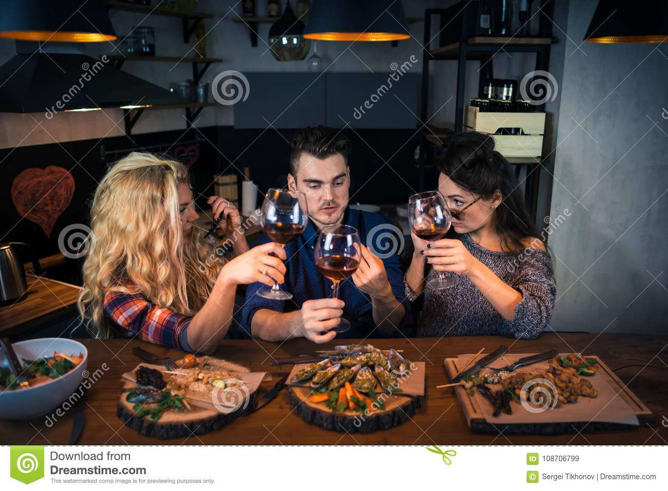 Group of attractive people have dinner together
