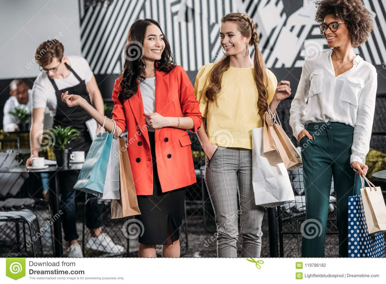 group of attractive young women with shopping bags