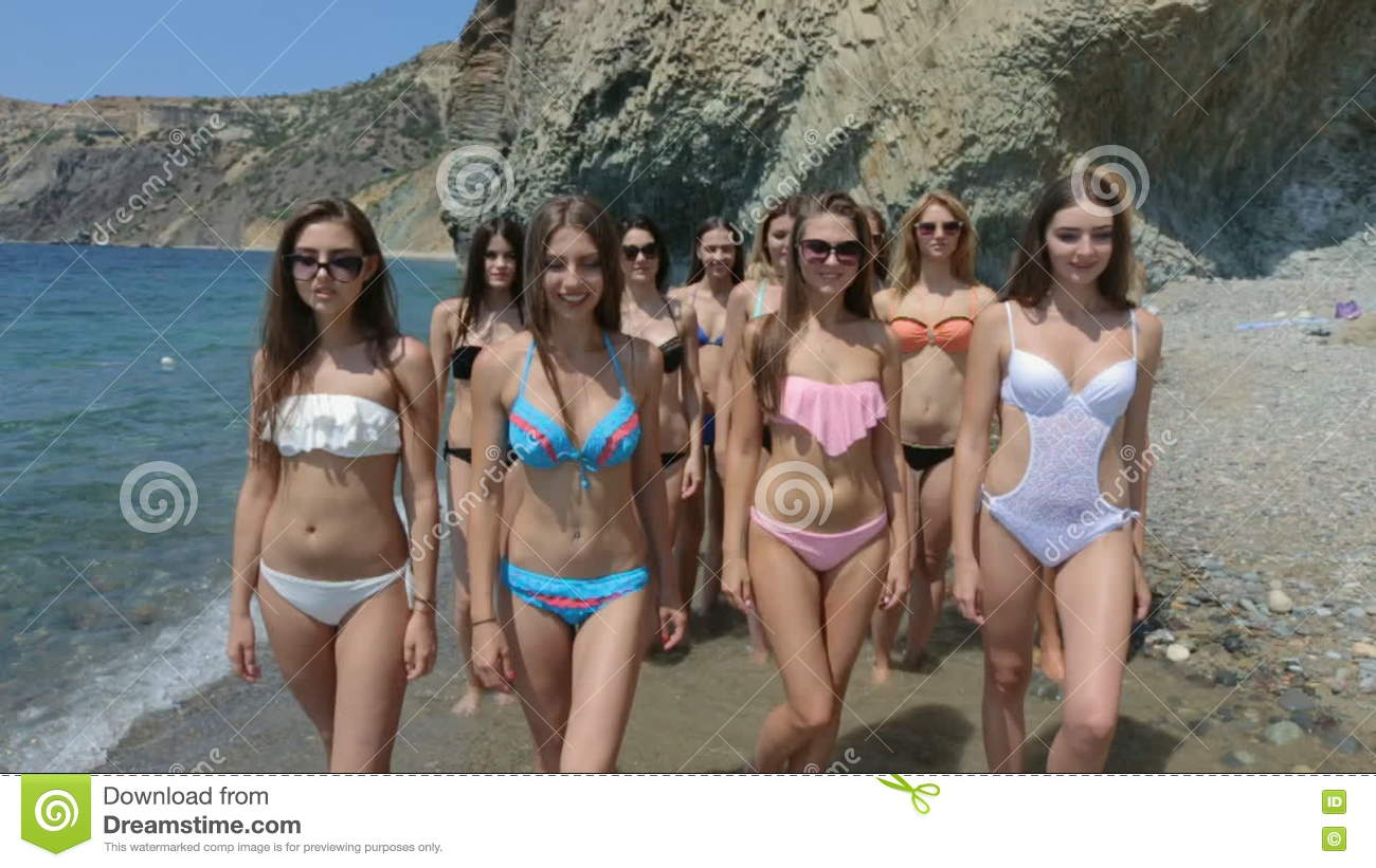 dcaad9de81 Group Of Beautiful Models In Bikinis Running Along The Shore Of A Beach  Stock Video - Video of girl, figure: 80423881