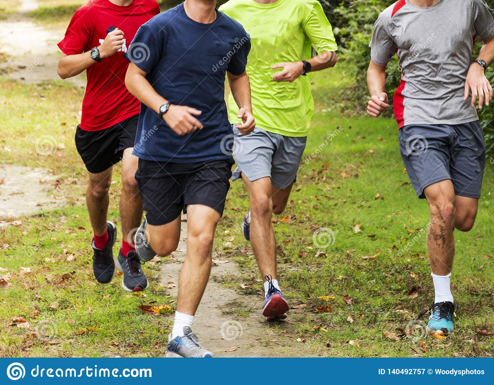 Group Of Boys Running Together On Grass Path Stock Image - Image of  healthy, aerobic: 140492757