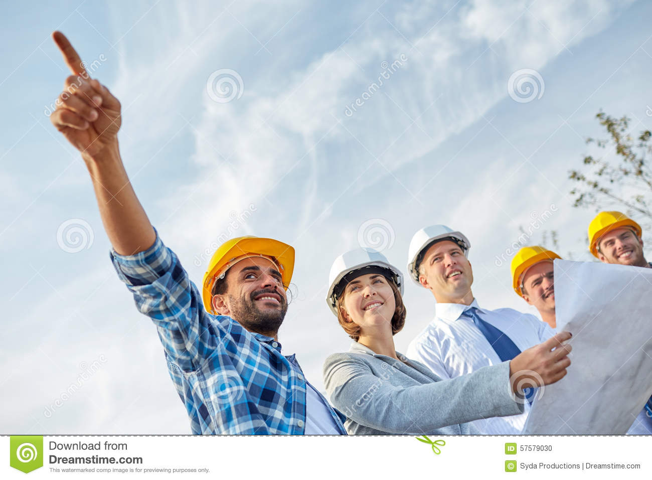 Group of builders and architects with blueprint