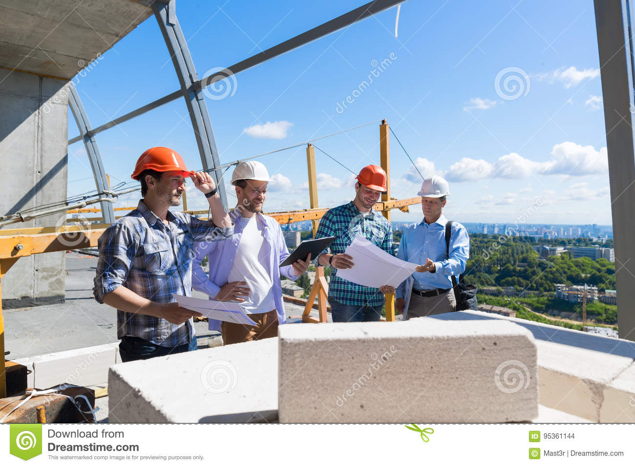 Group Of Builders On Construction Site Building Team Of Apprentices Meeting With Contractor Review Project Plan