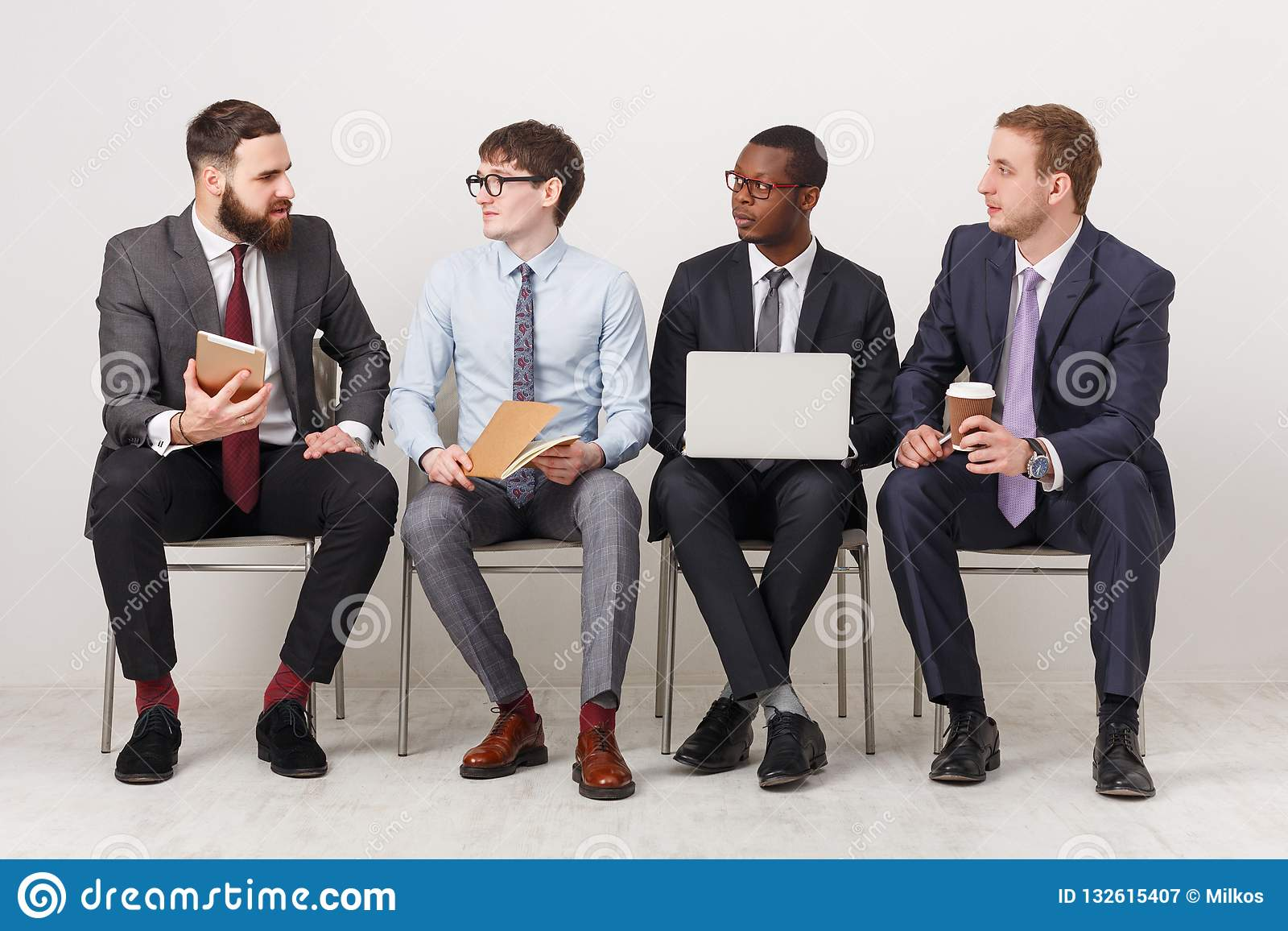 group-business-men-sitting-chairs-people-working-successful-using-gadgets-communication-modern-technologies-concept-132615407.jpg