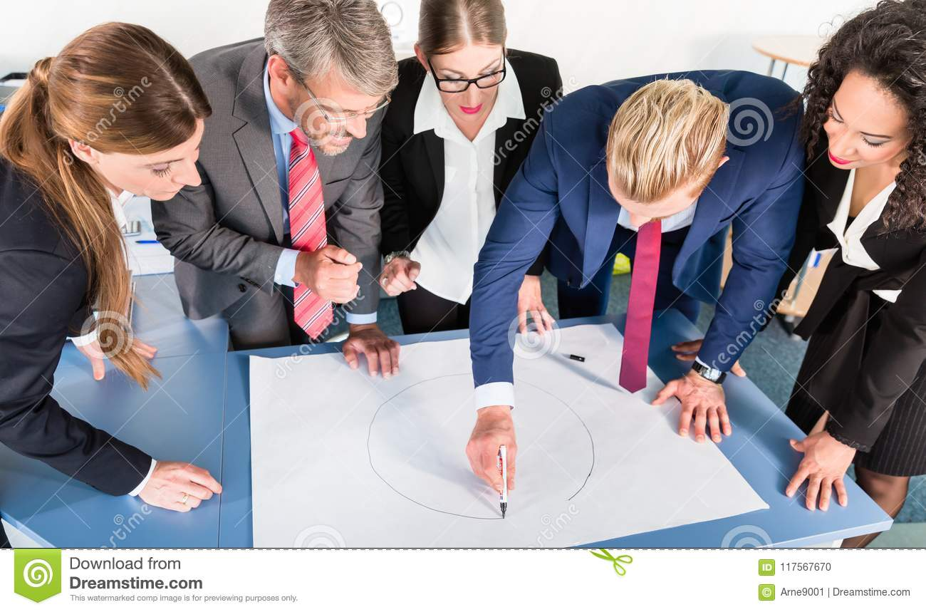 Group of business people analyzing data