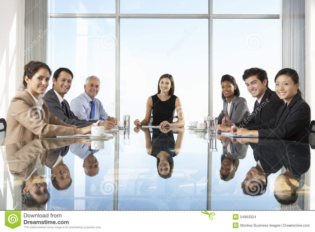 Group Of Business People Having Board Meeting Around Glass Table Stock ...
