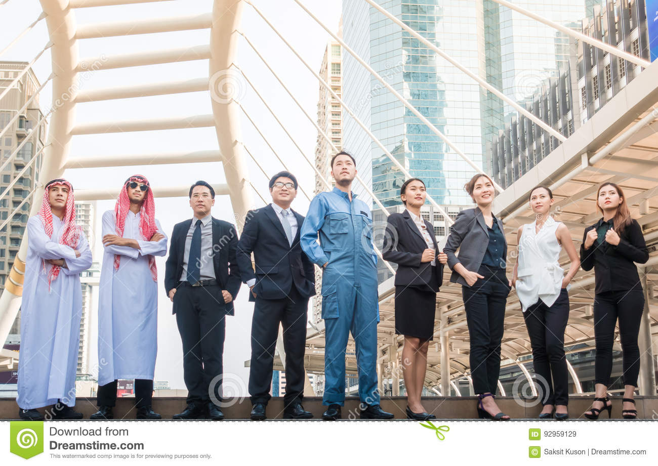 Group of Business People international have Arab , engineer , businessman Meeting with Sunset and city background.