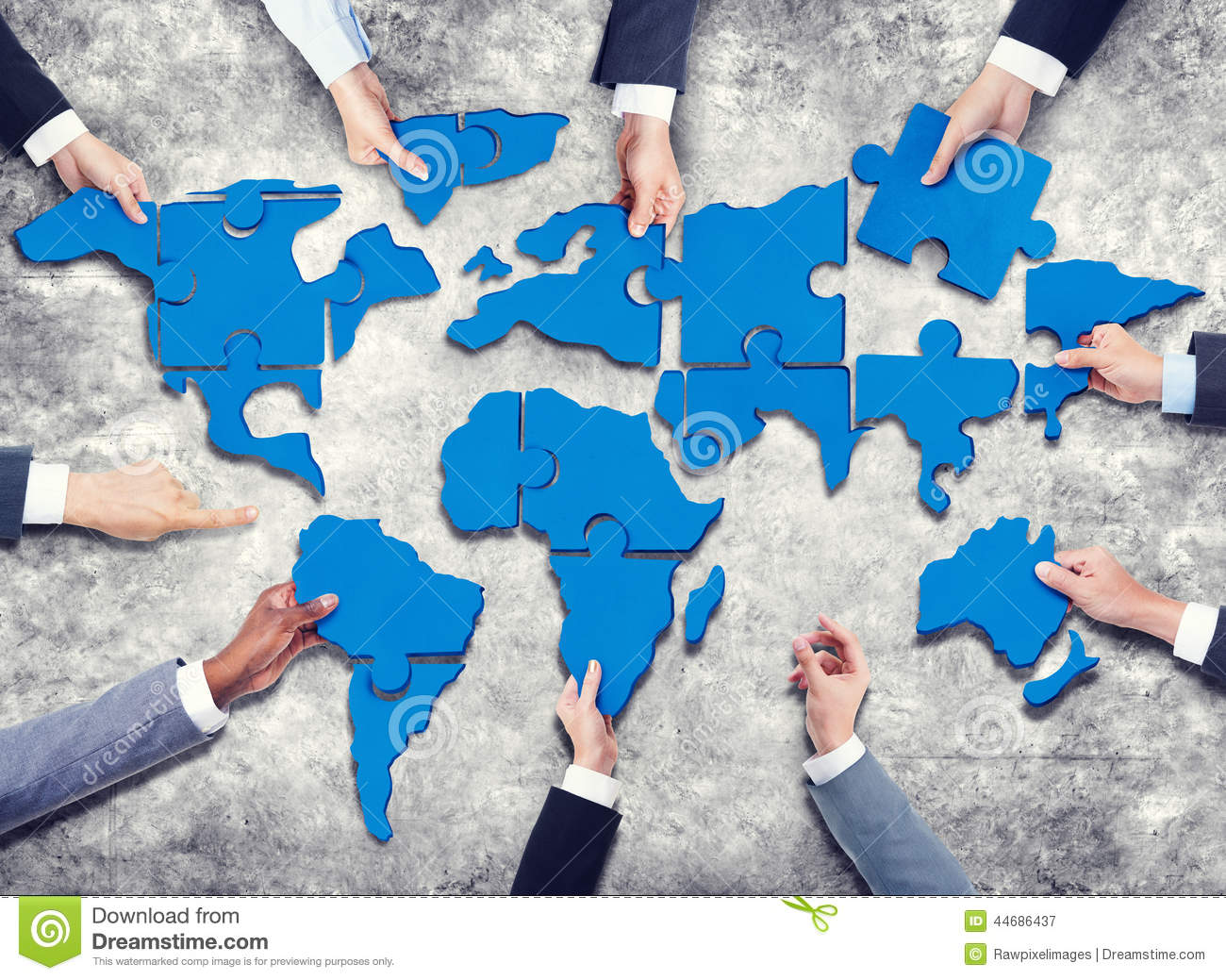 Group Of Business People With Jigsaw Puzzle Forming In World Map ...