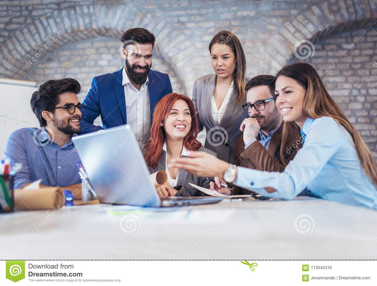 Business people meeting to discuss ideas in modern office