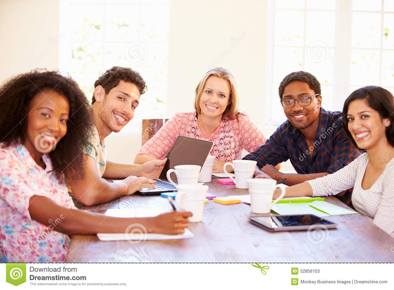 group of business people sitting around table in meeting stock image