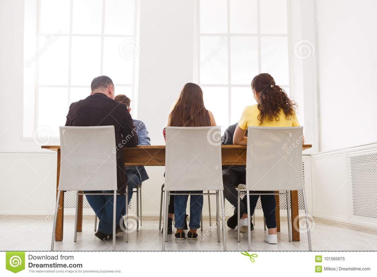 Group of business people sitting in office
