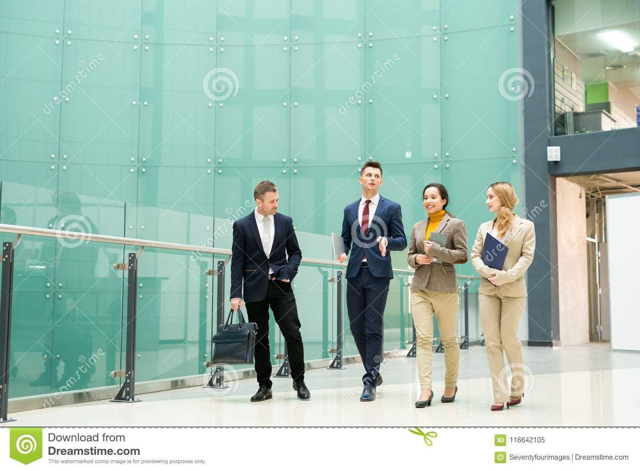 Group of Business People Walking from Office