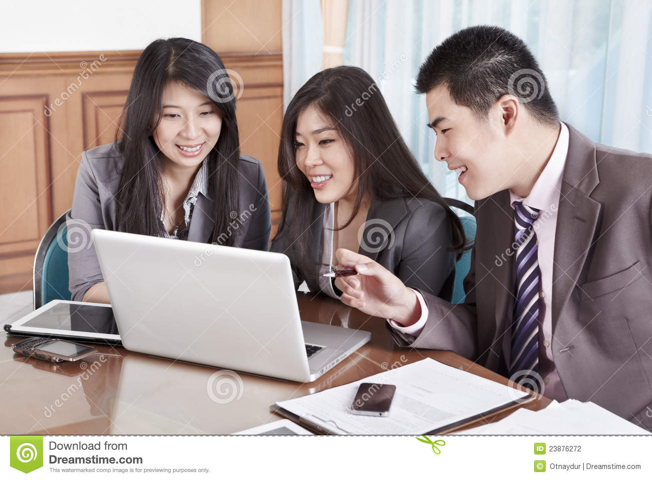 Stock photography group of business people working together