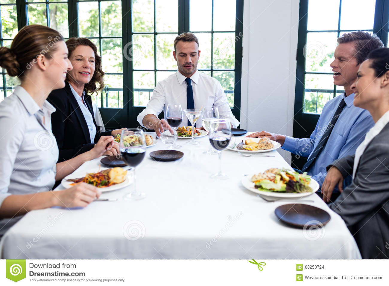Group Of Businesspeople At Business Lunch Meeting Stock ...