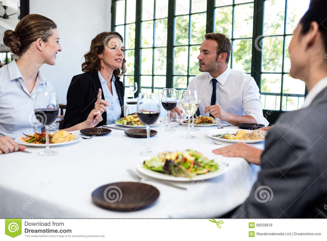 Group of businesspeople at business lunch meeting stock for Group lunch