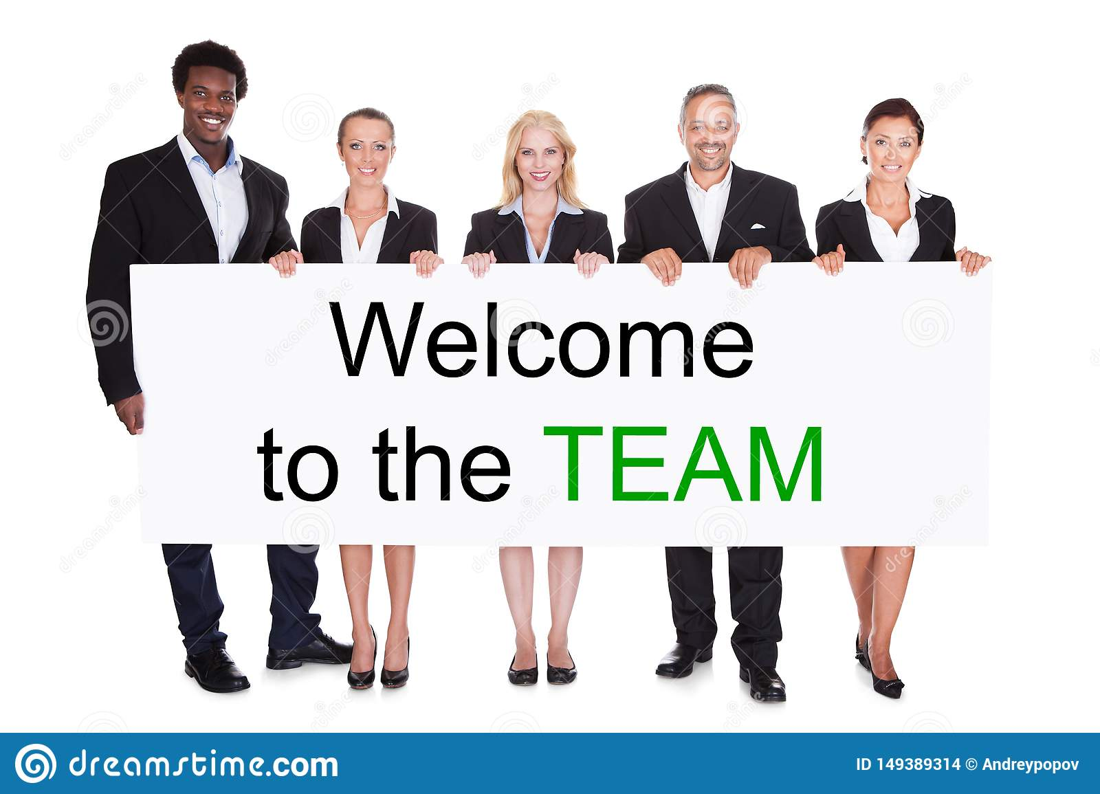 Group Of Businesspeople Holding Welcome To The Team Placard