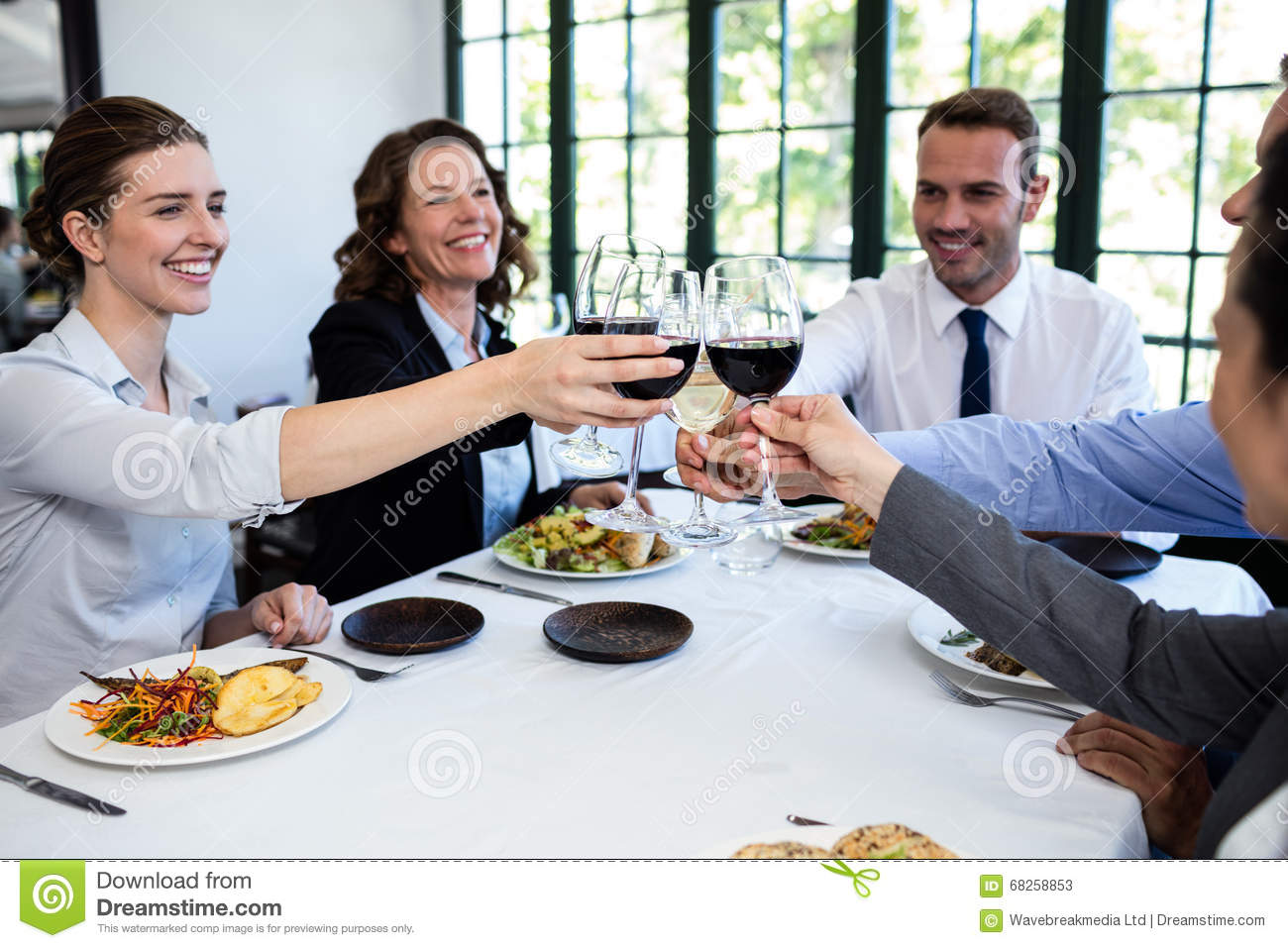 Group of businesspeople toasting wine glass during for Group lunch