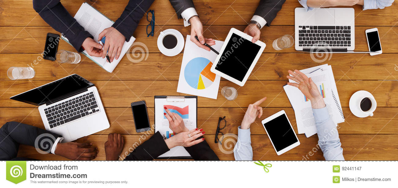 Group of busy business people meeting in office, top view