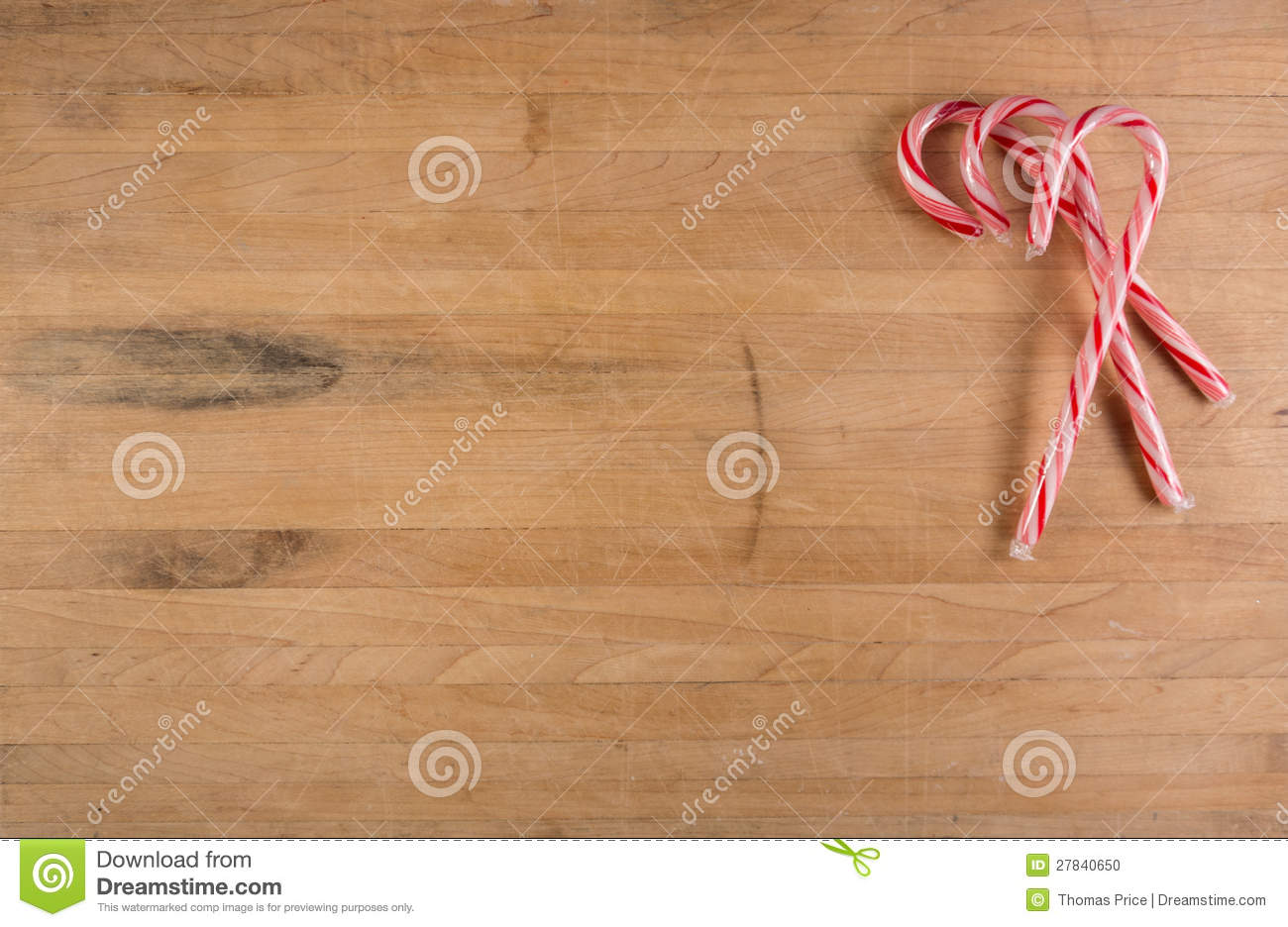 Group of Candy Canes Sits on Cutting Board