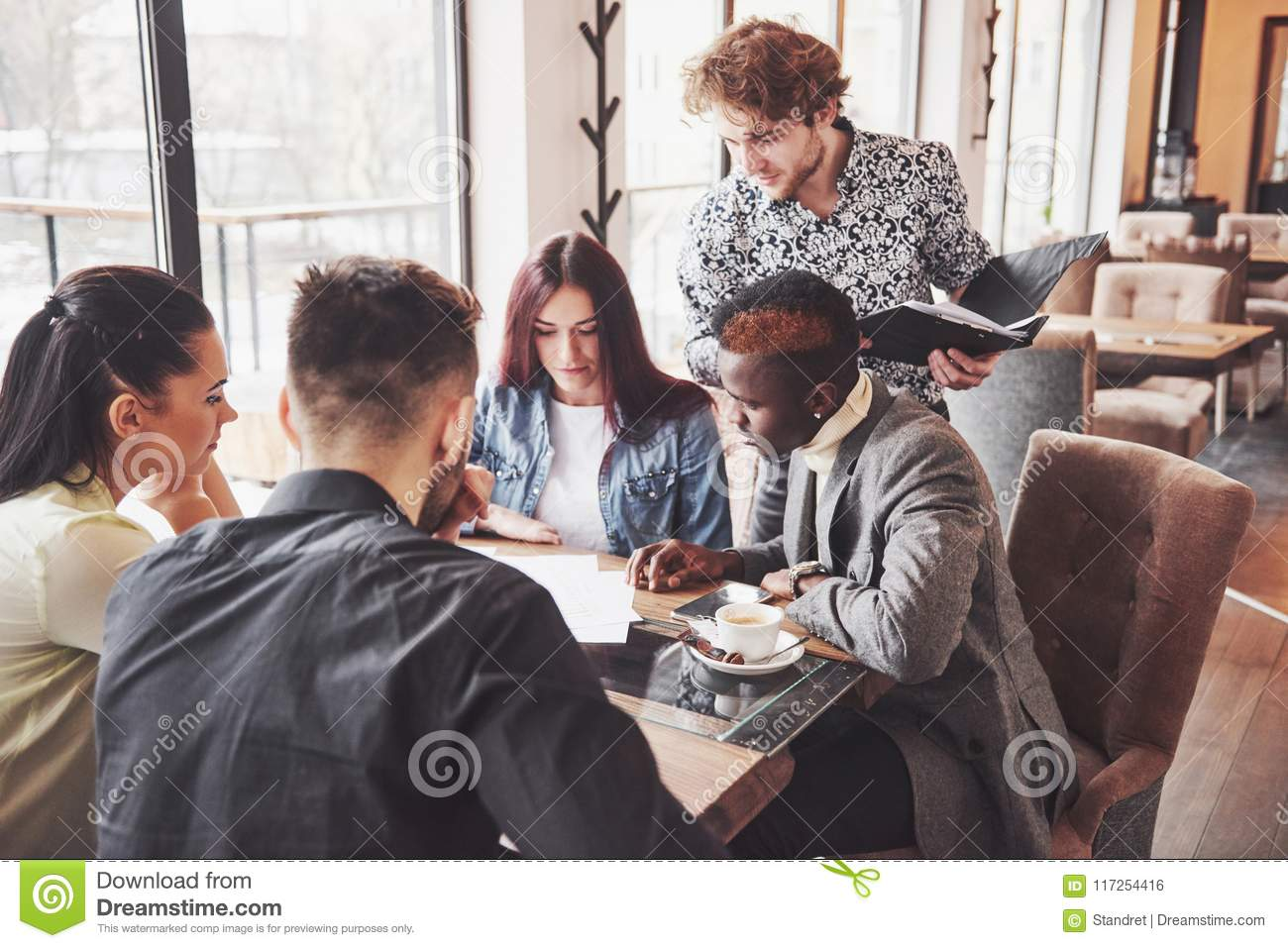 Group of casually dressed businesspeople discussing ideas. Creative professionals gathered for discuss the important