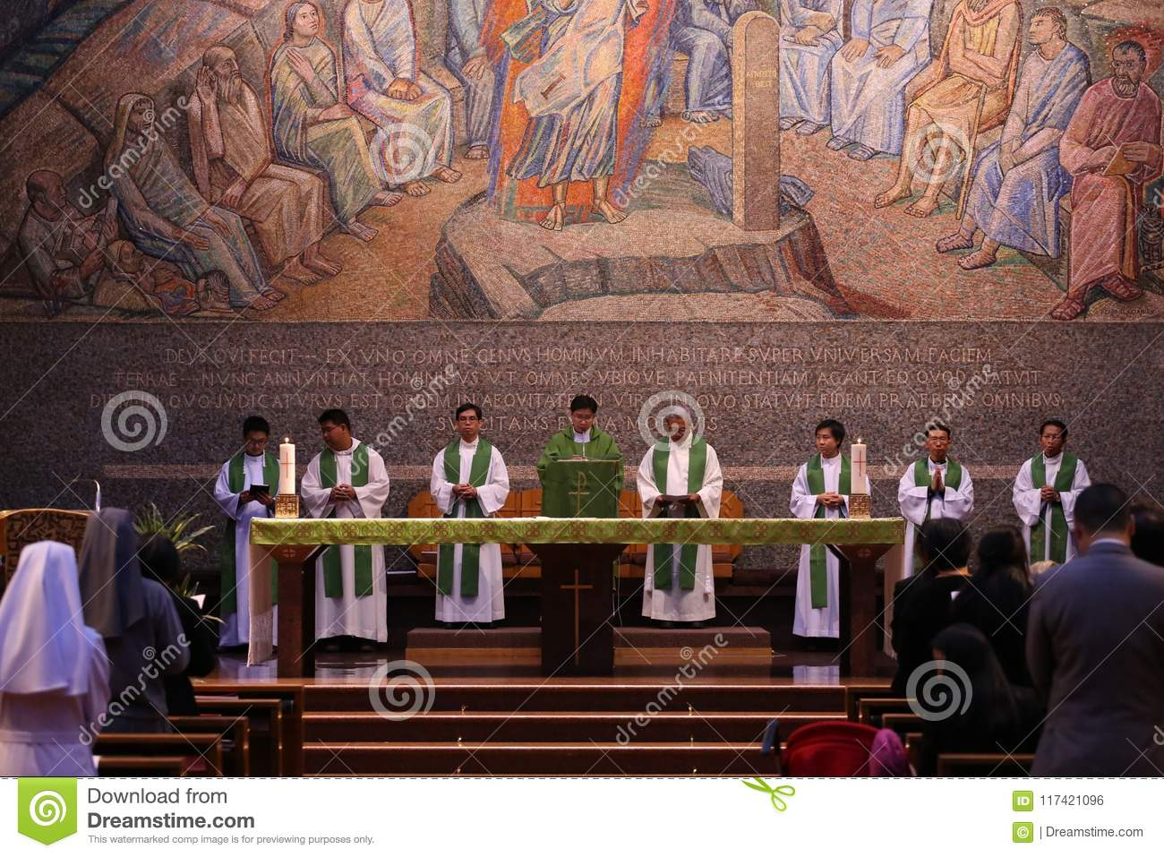 A group of Catholic priests and sisters in the Holy Mass