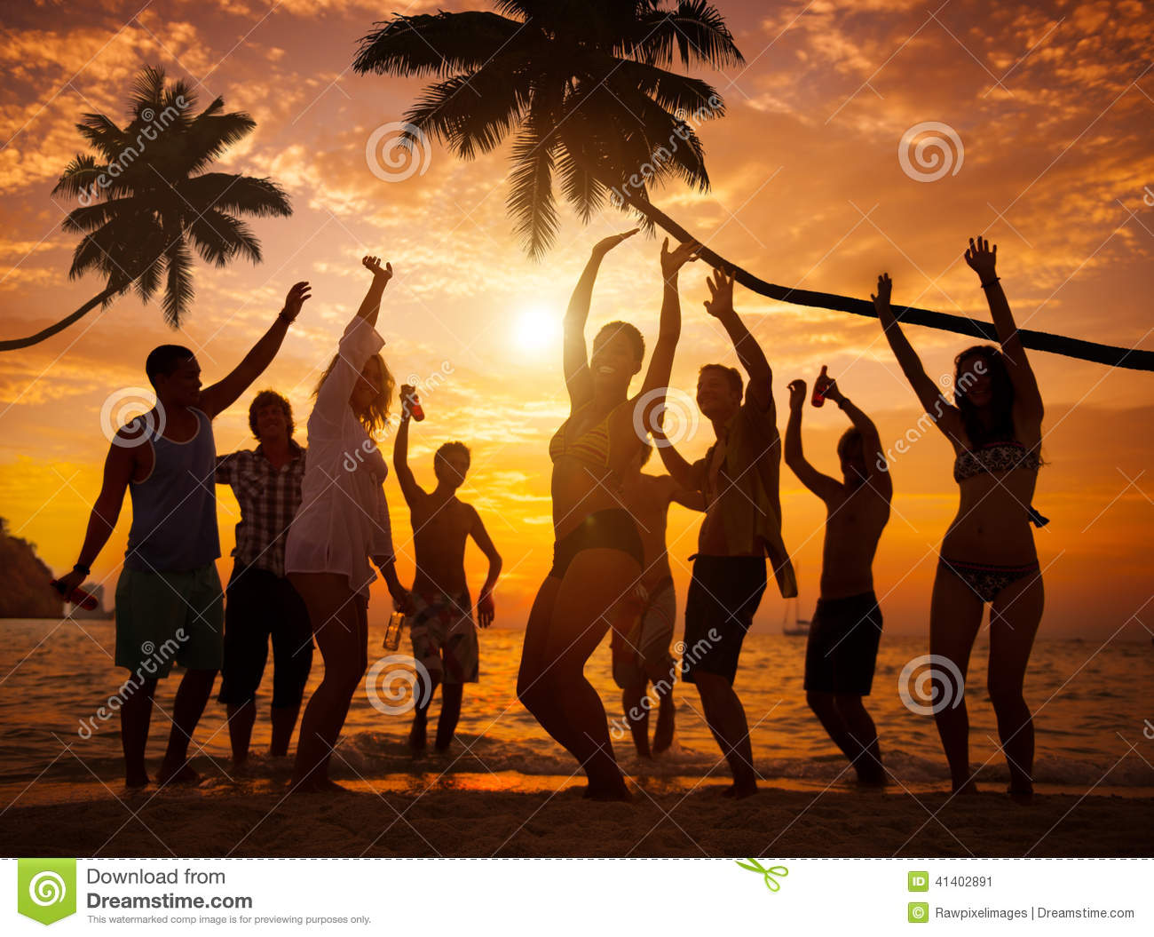 Group Of Cheerful People Partying On A Beach Stock Photo ...