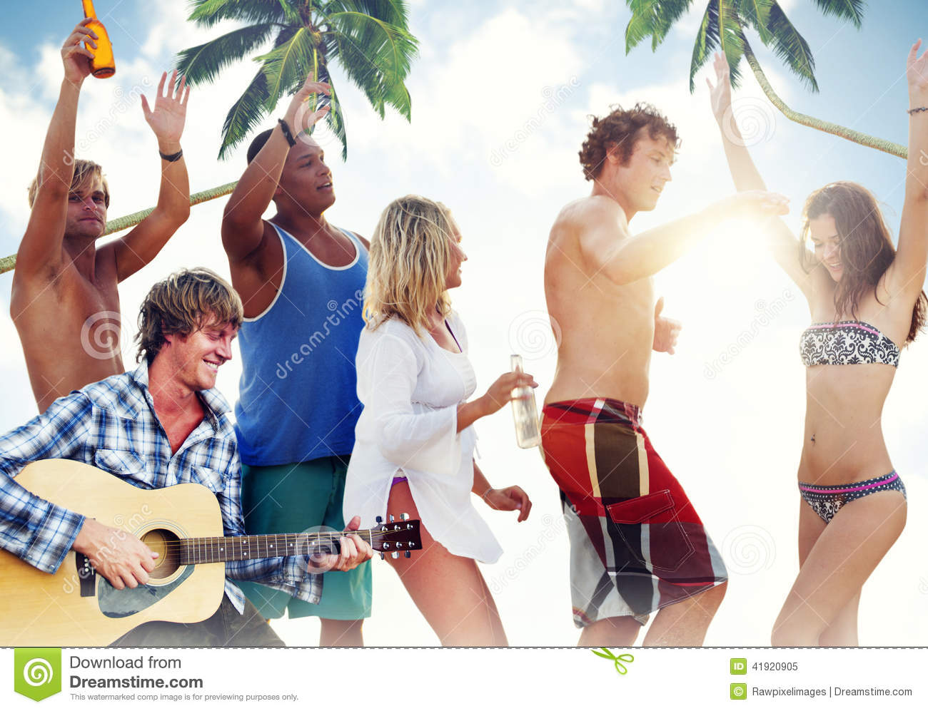 Group Of Cheerful People Partying On A Beach