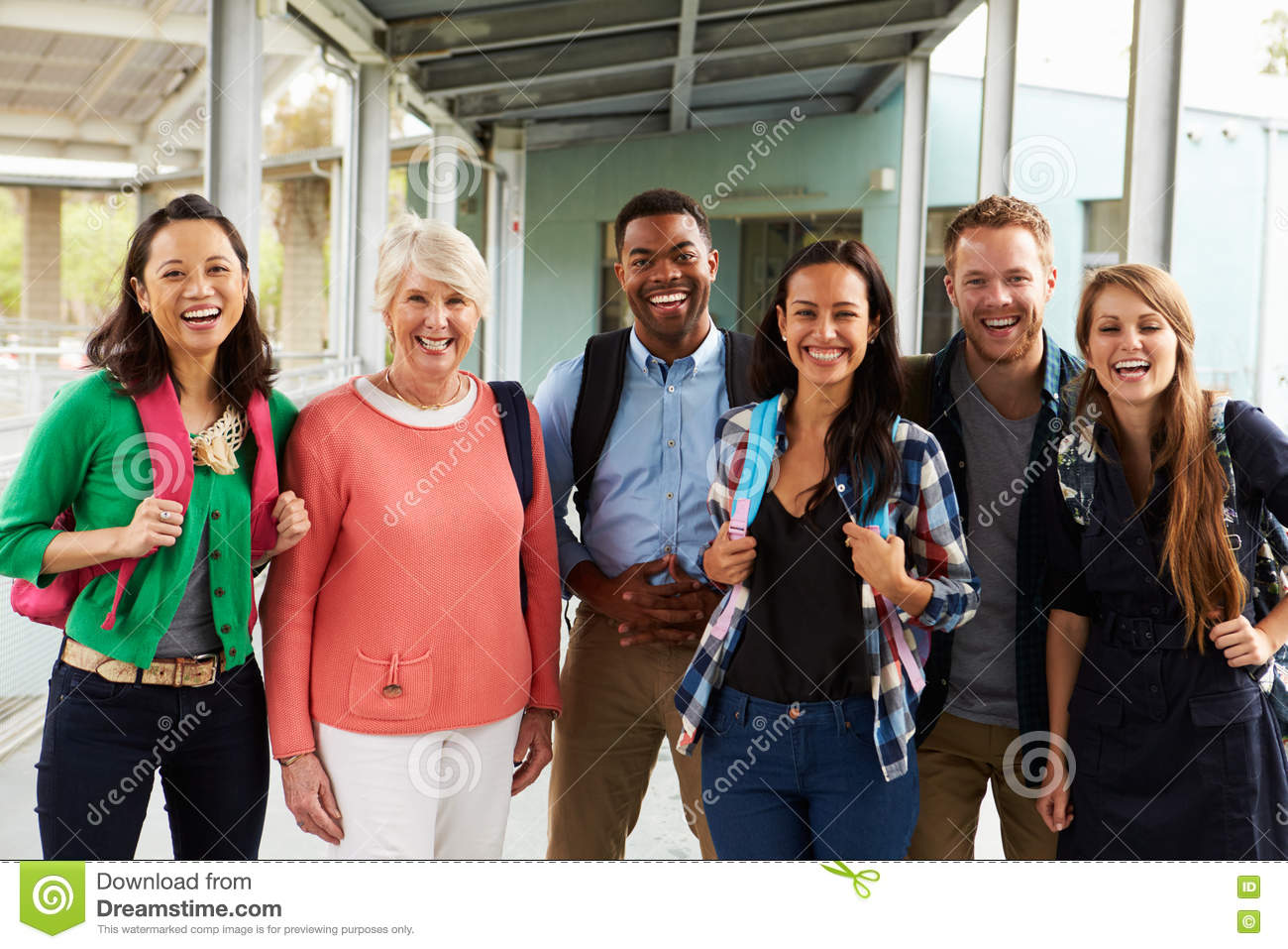 A group of cheerful teachers hanging out in school for Hanging groups of pictures