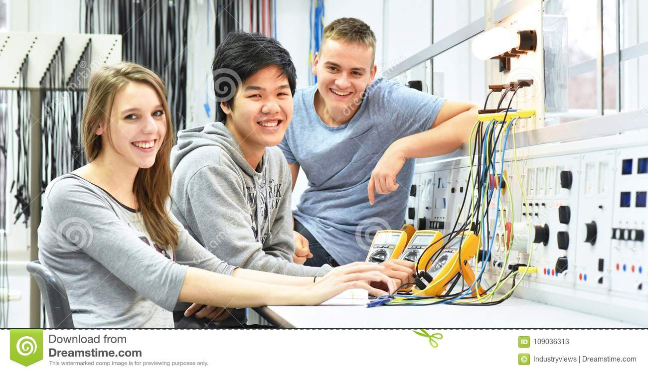 group of cheerful young students in vocational education and training for electronics